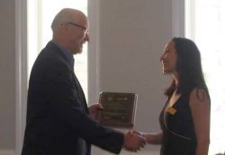 Mitro Digital Marketing accepting a plaque for ESBY award